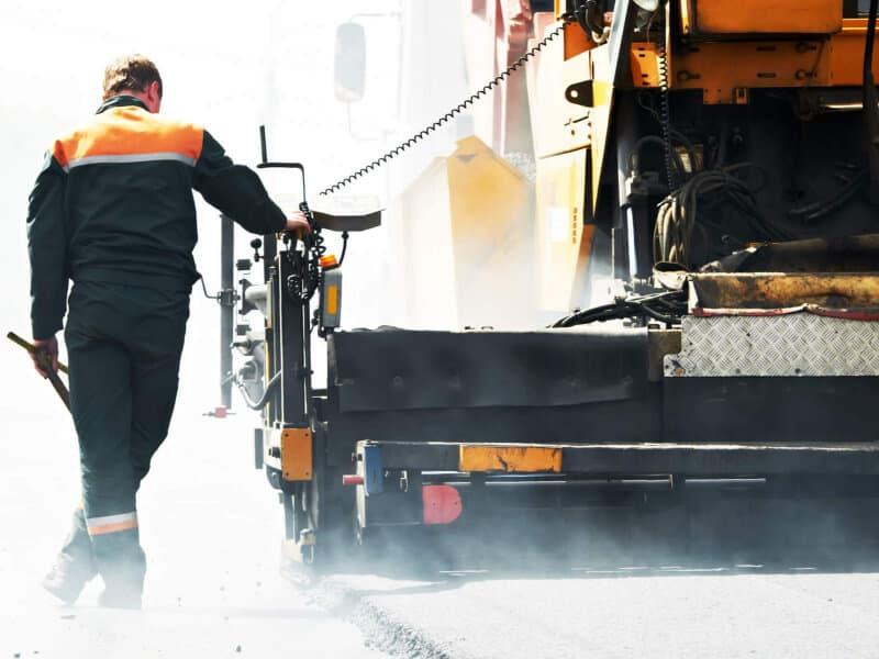 Asphalt driveway paving contractors repairing road for asphalt maintenance